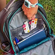 Ultima Replenisher sticks in a backpack